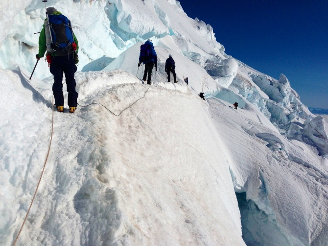 Crossing a large crack in the emmonds glacier.  This was one of the spicier parts of the day