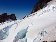 Climbers crossing an area of icefall hazard on the Ingram glacier.