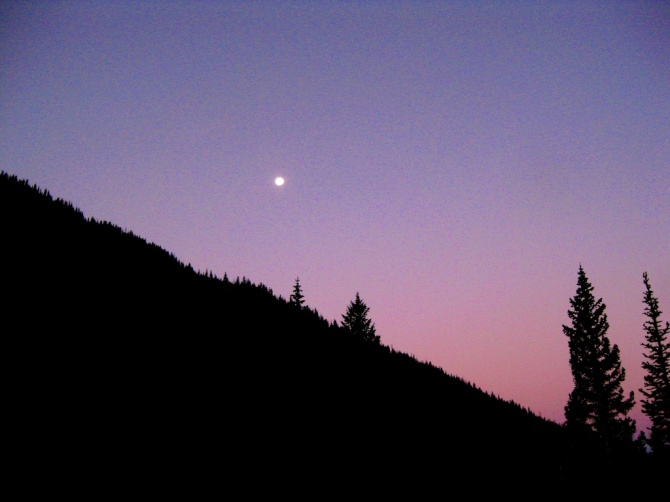The sun rise creates a colorful backdrop to the moon set. (Photo by Jeremy)