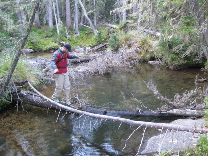 Christian crossing Cascade Creek on a slippery log.  Creek was at least 4 ft deep here