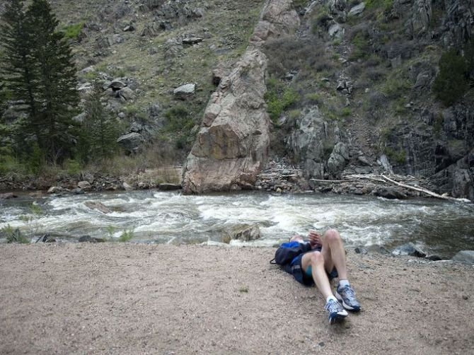 A struggling runner lays by the river (