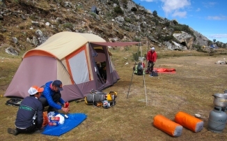 The team packs up at basecamp to move higher